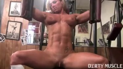 Naked Female Bodybuilder Tattooed Muscular in the Gym