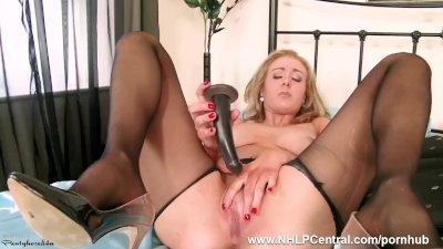 Horny blonde Sapphire Blue vigorously fucks toy in seamless nylon pantyhose