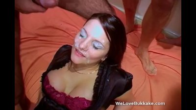 Repeated cumshots over a British MILFs face and eyes