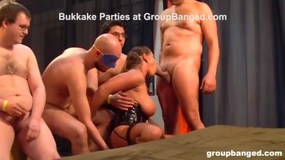 Masked Mistress Gets into Bukkake Fest