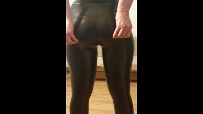 Teasing in tight leather leggings